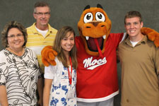 family photo taken with mocsie, the school mascot