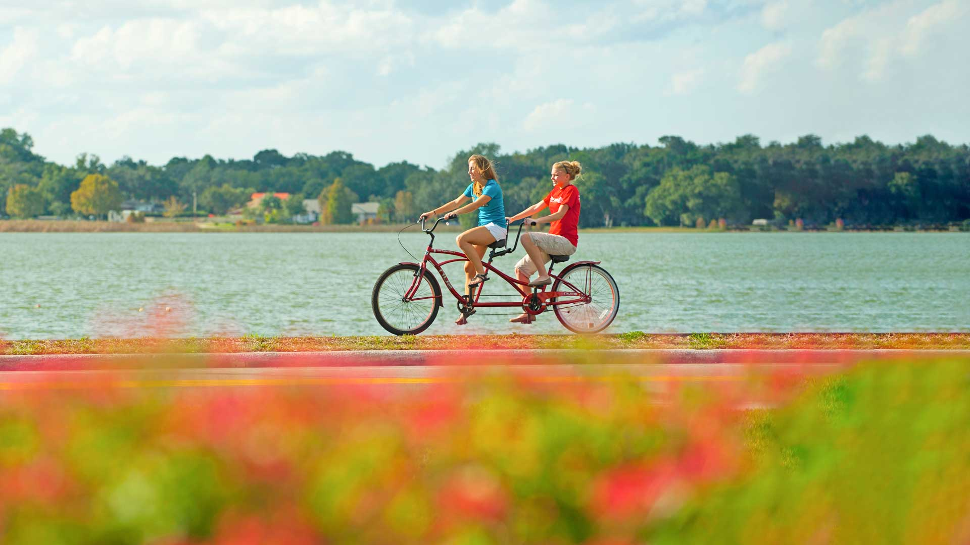 students enjoying a bike ride around lake hollingworth in lakeland, florida