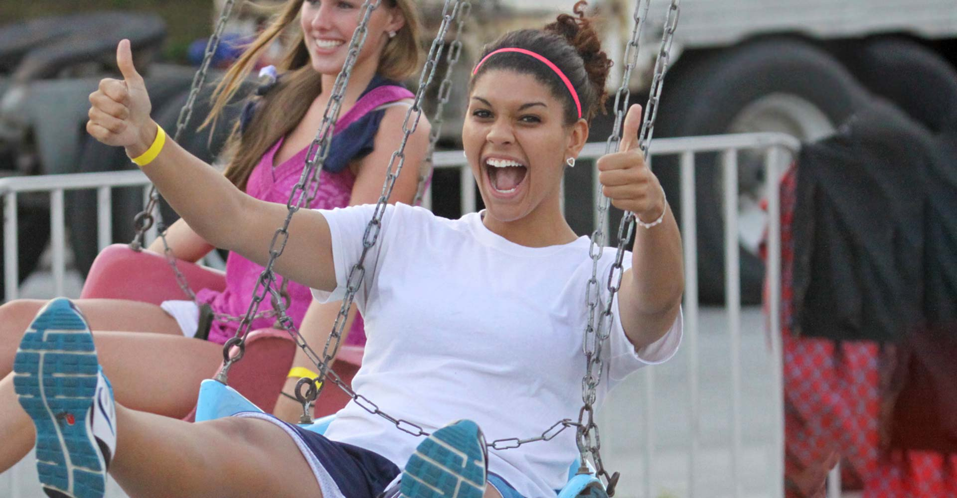 Student enjoying the swing ride at the Fair Well event.