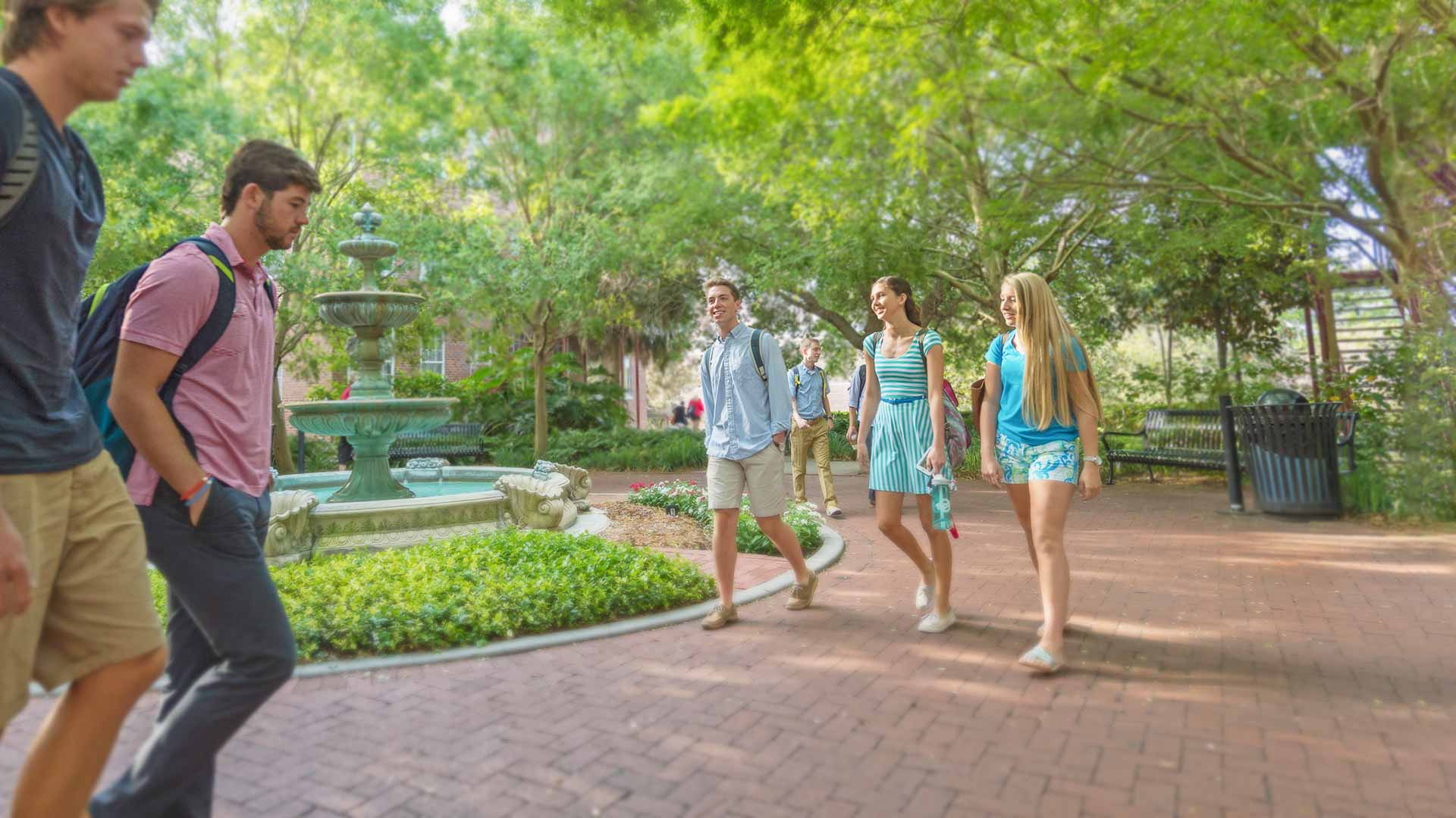 students walking around the beautiful florida southern campus