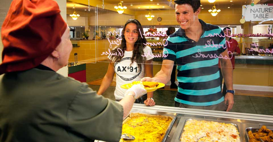Students receiving food in the cafeteria