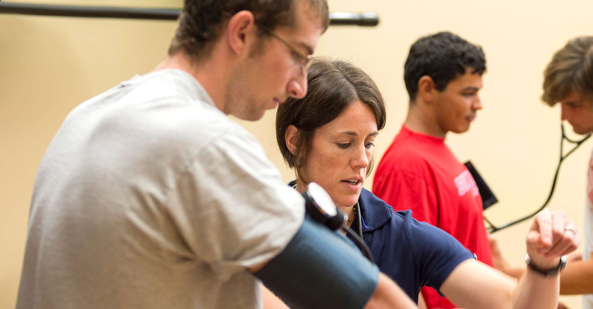 Teacher working with exercise science student