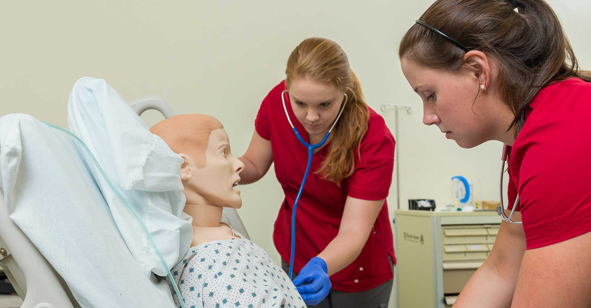 Nursing students working with state-of-the-art training equipment