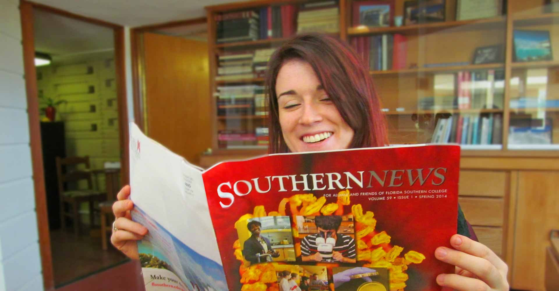 Alumni reading the Southern News magazine