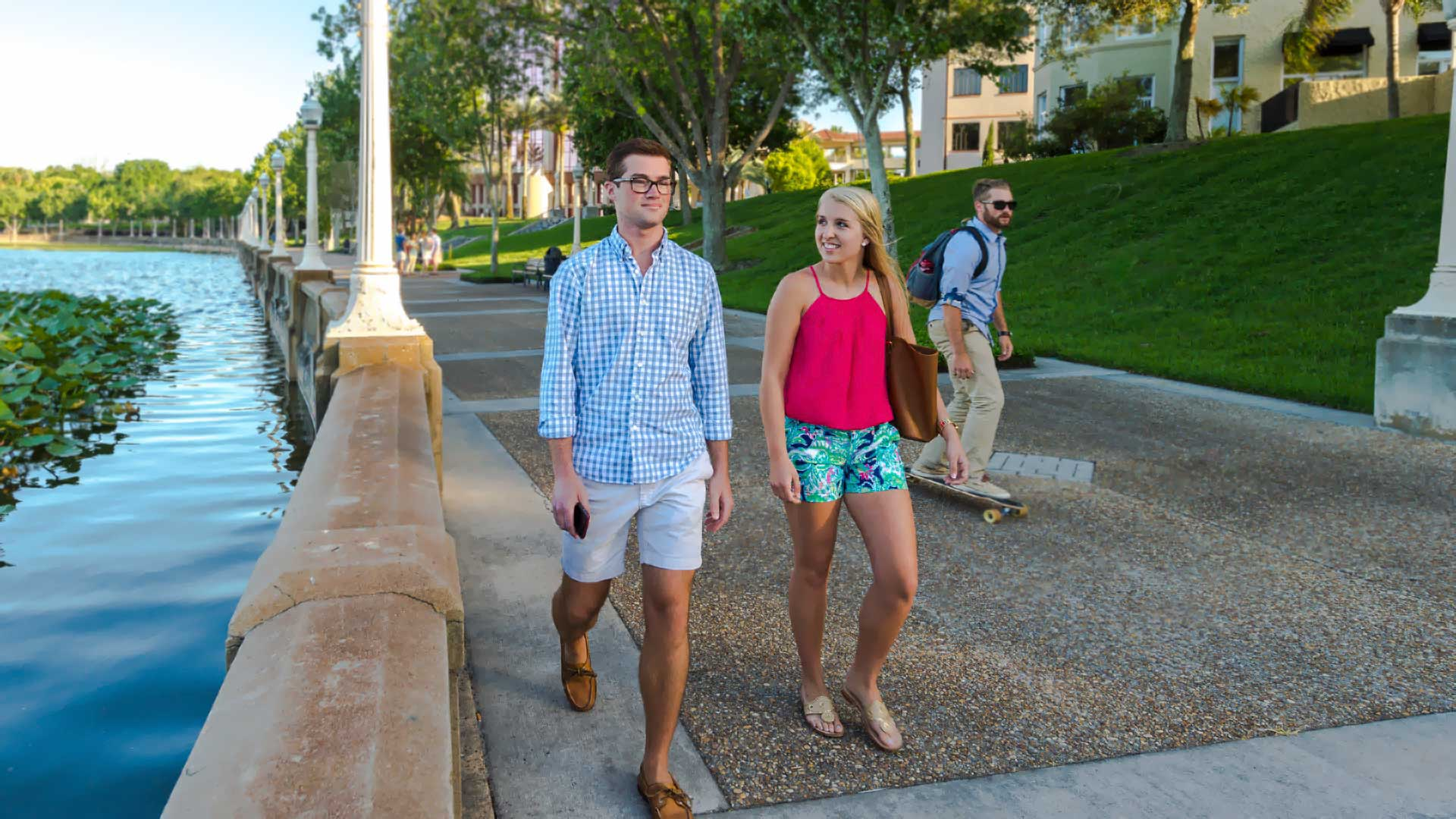 students enjoying a walk around lake mirror in lakeland, florida