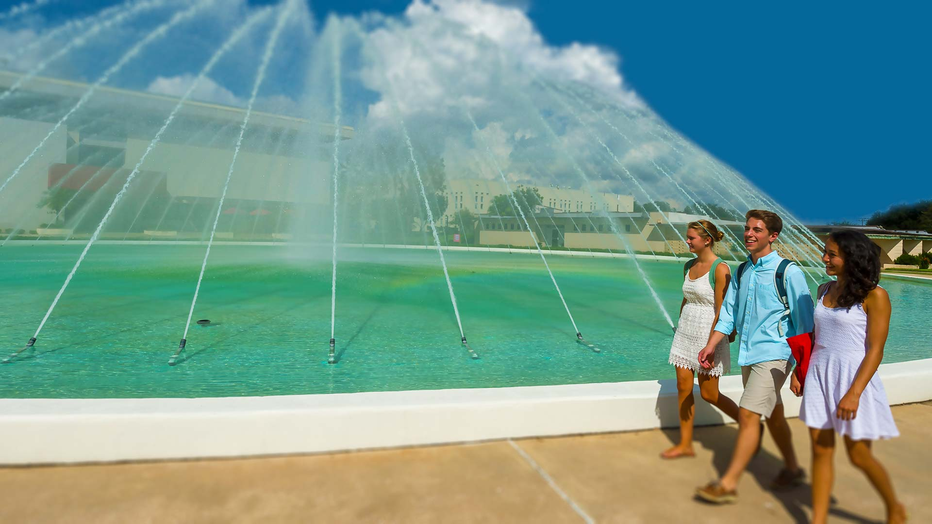 students walking in front of the water dome