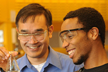 student and professor working together in a lab