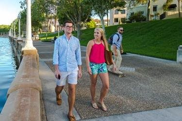 students walking around lake