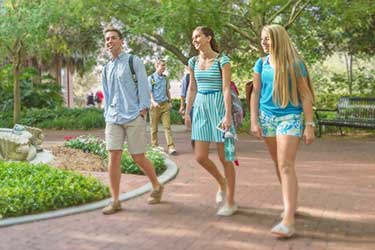 admissions students walking on campus