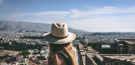 Girl overlooking Mediterranean city.