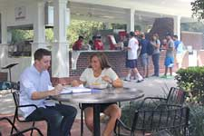Students eating outside at The Buck Stop