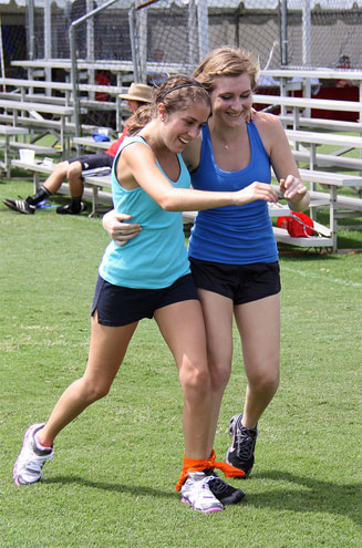 Students running in a three-legged race.