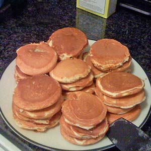 Stack of pancakes on a counter top.