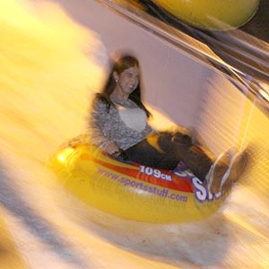 student riding a sled at the winter wonderland