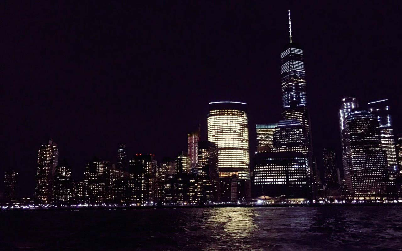 View of New York City at night from a water taxi.