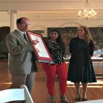 Dr. Phil Hartman presents the AED charter to Aryianna Woody and Dr. Nancy Morvillo.