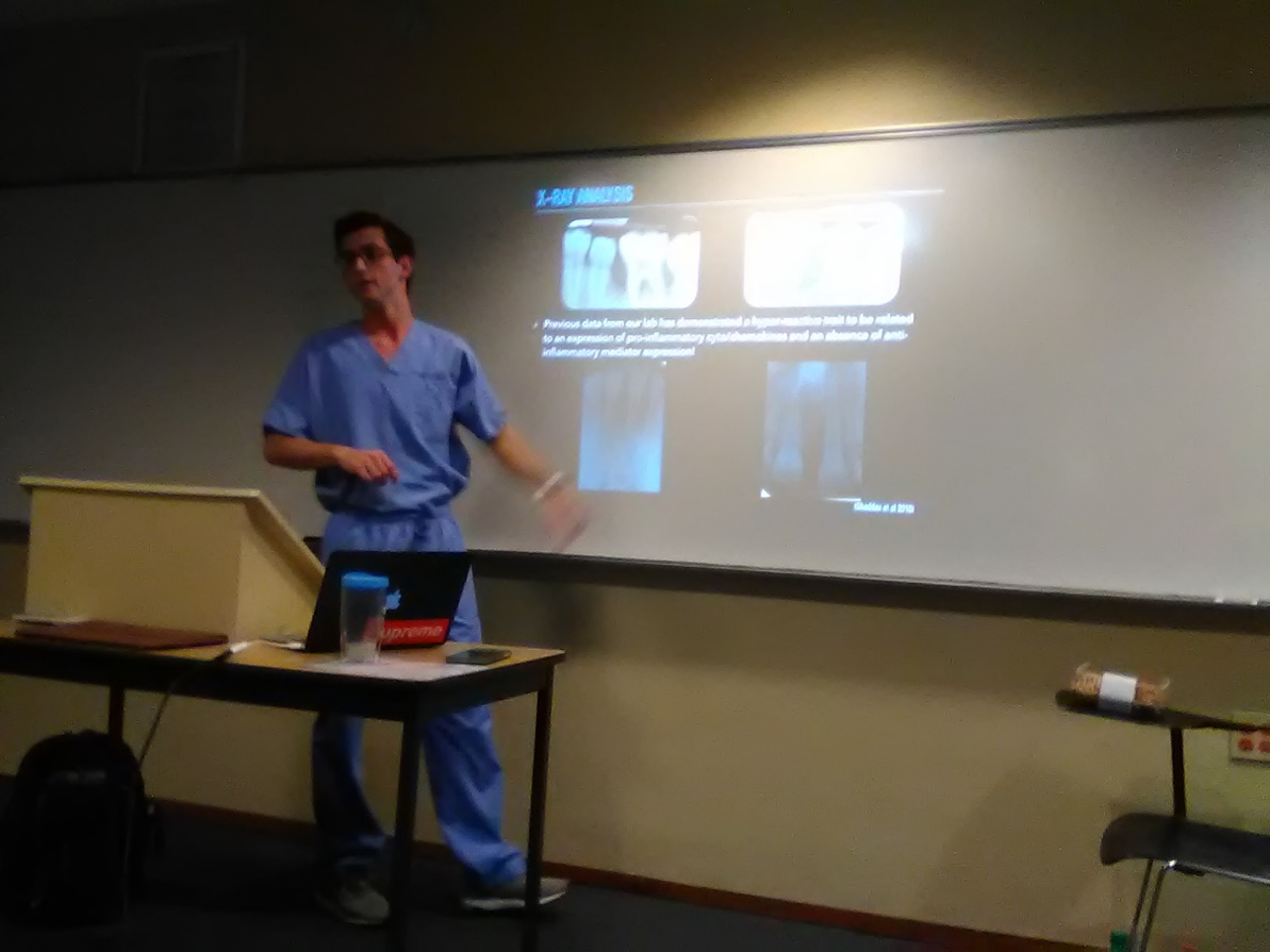 Blake presenting his research to the FSC Pre-Dental Society.