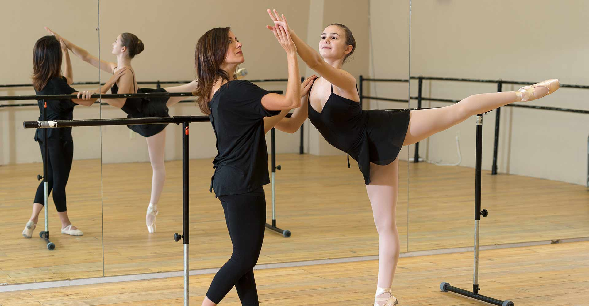 student and instructor work on dance form