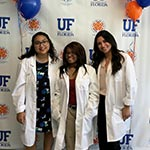 Three female students participating in the SHPEP at the University of Florida.