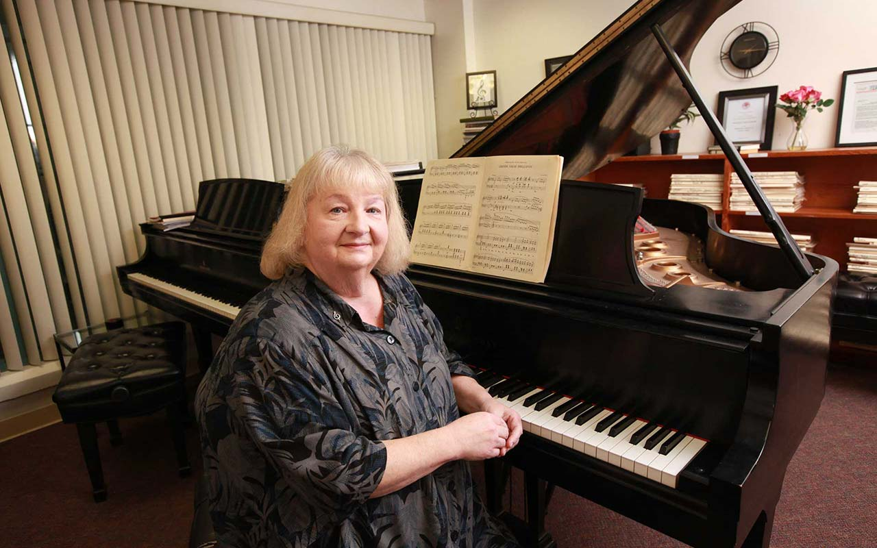 professor paula parché in her office at the piano