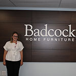 Rachael Buckel '21 in front of the Badcock & More Home Furniture Sign.