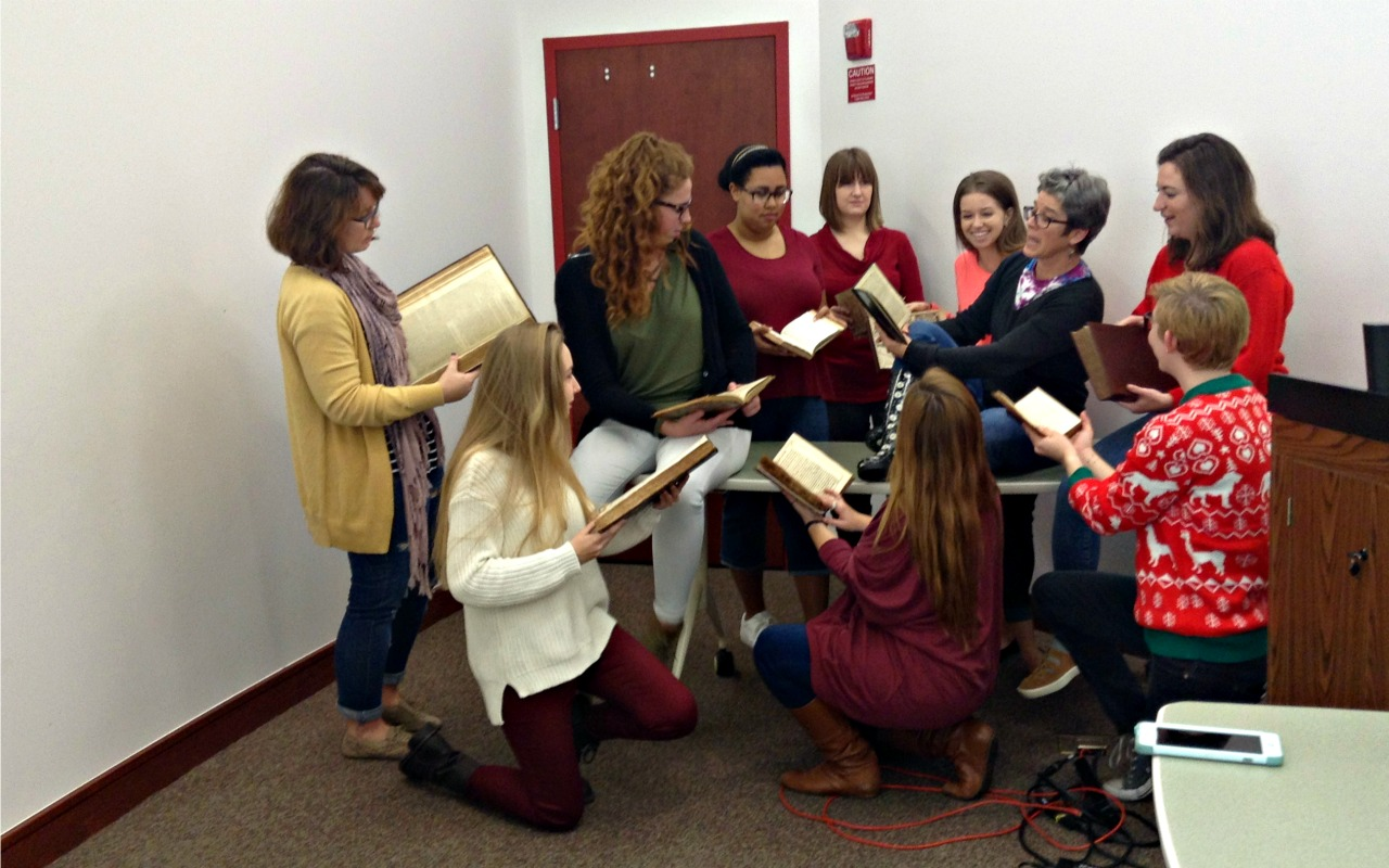 The ENG 3313 class in the archives with the old books.