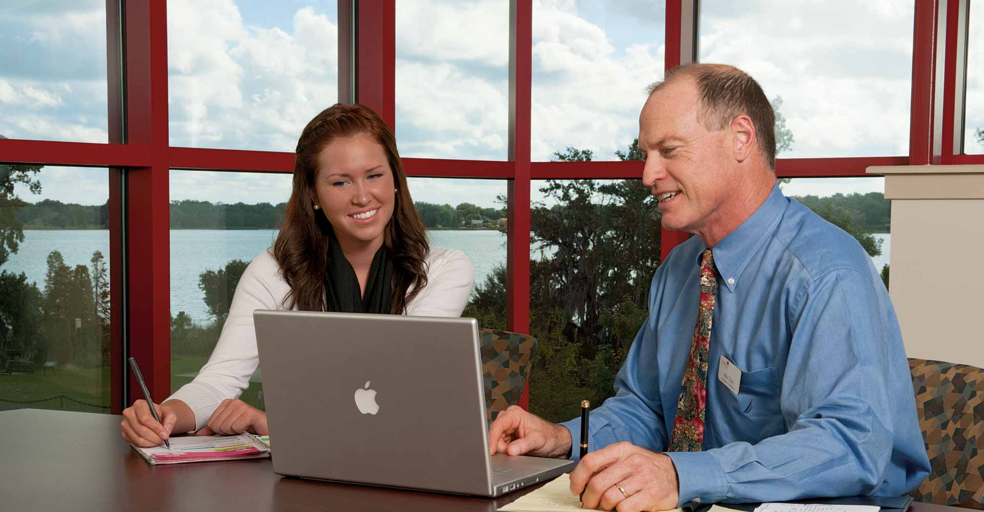 florida southern professor helps a student prepare for business career