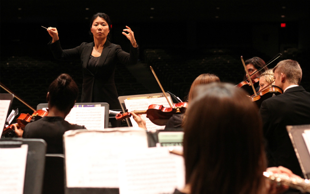 Orchestra conductor Kira Omelchenko directs the chamber team.