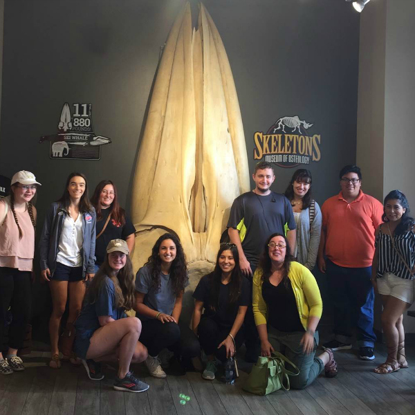 Visiting Assistant Professor of Biology Laura Habegger and her students at the museum.