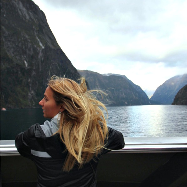 Kylie on a boat in the fjords.