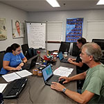 From left to right: Professor Daugherty, Dr. Wolovich and Dr. Kjellmark exploring the uses of GIS technology at the Sea Grant UF training program.