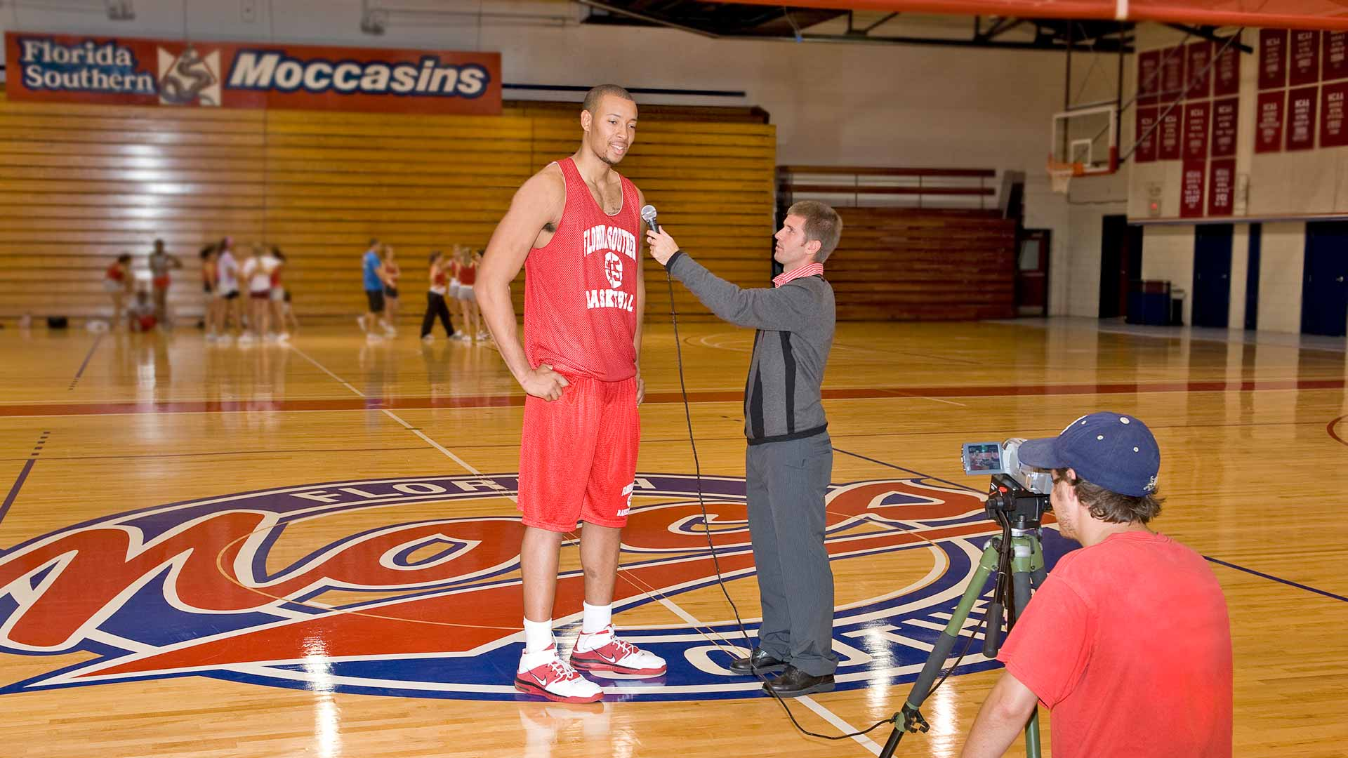 sports communication student interviewing a basketball player