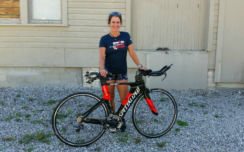 Comm professor Dr. Mary Beth Bradford with her racing bike.