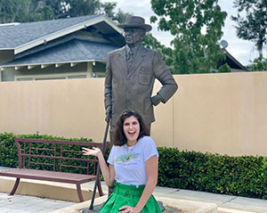 Jean Howell '20 with the statue of Frank Lloyd Wright.