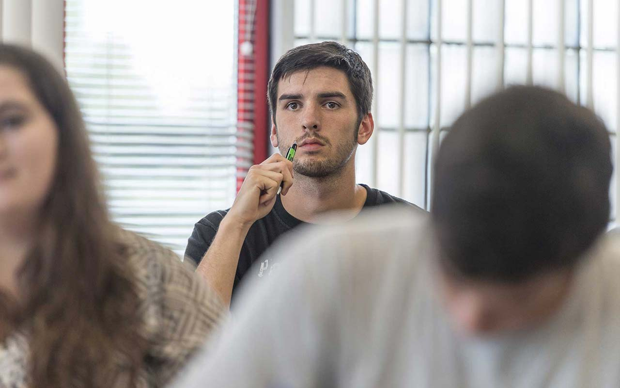 international business student listens intently in class