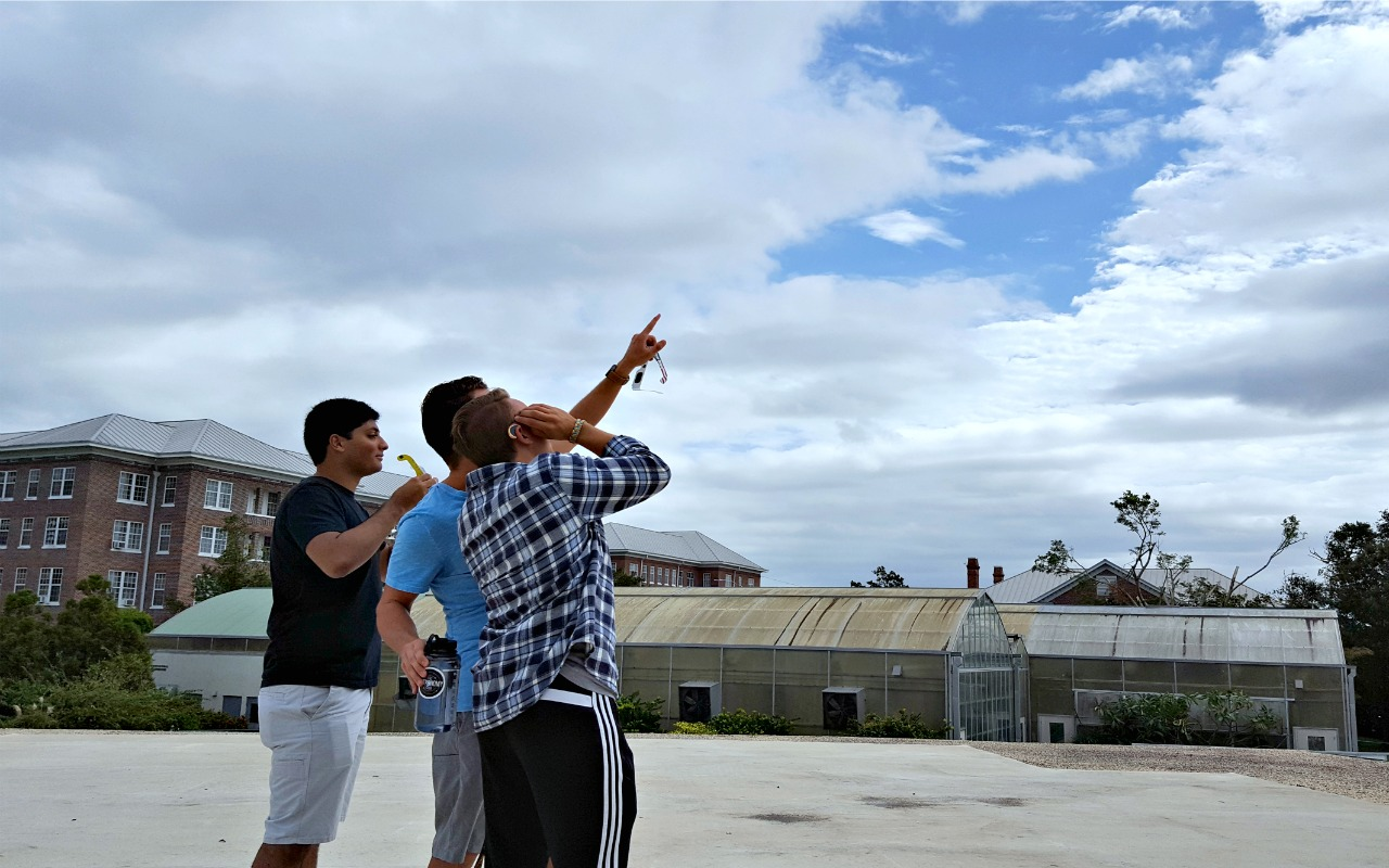 FSC Astronomy Club members explaining solar eclipse phenomena from the roof of Polk Science.