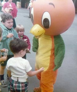 Orange Bird walk-around character with children